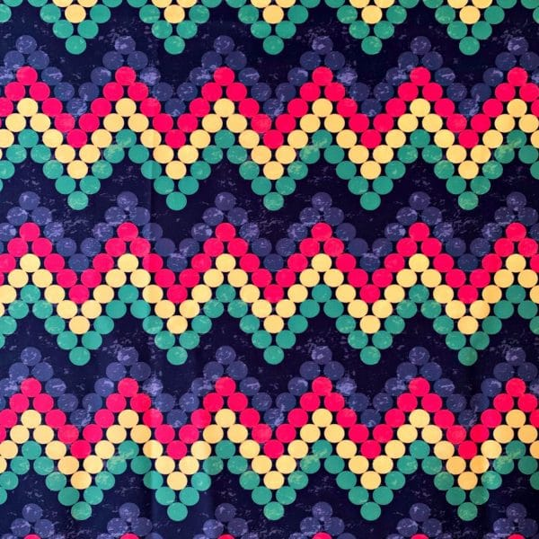 Rasta Print Fabric for swimwear and activewear - featuring red, yellow, green, grey and black dots in a zig zag pattern