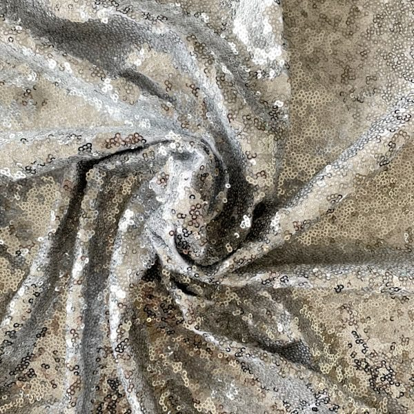 Wholesale luxury sequin fabric = silver sequin stretch fabric - Solid Stone Fabrics, Inc.